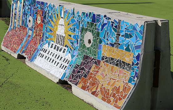 Lansing mosaic on side of concrete road divider
