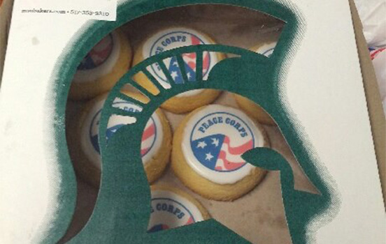 Peace corps cookies in an MSU spartan helmet box